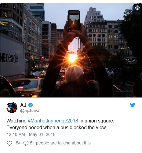 Twitter post by @ajchavar: Watching #Manhattanhenge2018 in union square. Everyone booed when a bus blocked the view.