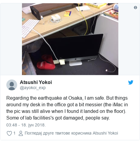 Twitter post by @ayokoi_exp: Regarding the earthquake at Osaka, I am safe. But things around my desk in the office got a bit messier (the iMac in the pic was still alive when I found it landed on the floor). Some of lab facilities's got damaged, people say.