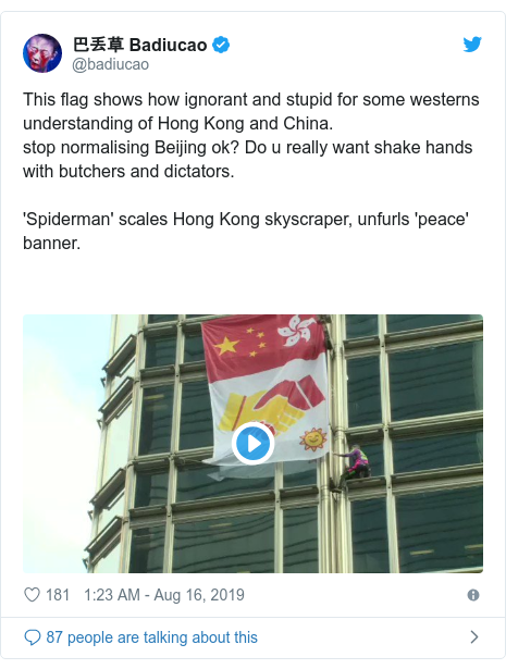Twitter post by @badiucao: This flag shows how ignorant and stupid for some westerns understanding of Hong Kong and China.stop normalising Beijing ok? Do u really want shake hands with butchers and dictators. 'Spiderman' scales Hong Kong skyscraper, unfurls 'peace' banner.