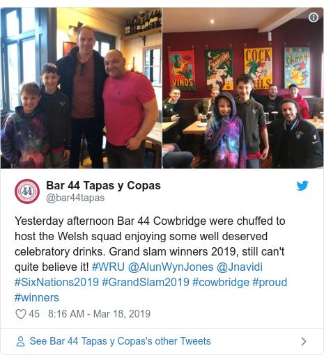 Twitter post by @bar44tapas: Yesterday afternoon Bar 44 Cowbridge were chuffed to host the Welsh squad enjoying some well deserved celebratory drinks. Grand slam winners 2019, still can't quite believe it! #WRU @AlunWynJones @Jnavidi #SixNations2019 #GrandSlam2019 #cowbridge #proud #winners