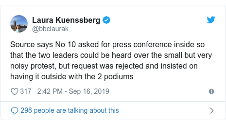 Twitter post by @bbclaurak: Source says No 10 asked for press conference inside so that the two leaders could be heard over the small but very noisy protest, but request was rejected and insisted on having it outside with the 2 podiums