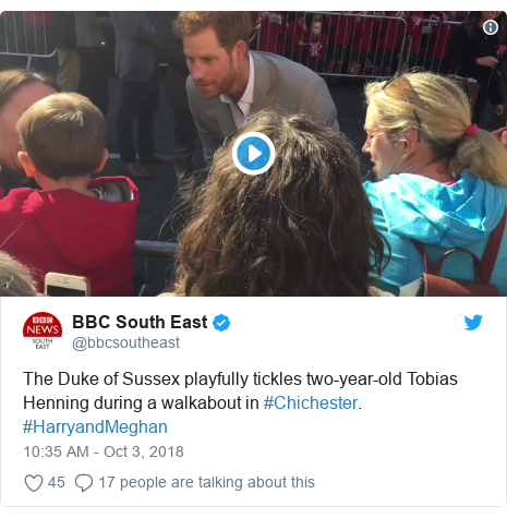 Twitter post by @bbcsoutheast: The Duke of Sussex playfully tickles two-year-old Tobias Henning during a walkabout in #Chichester. #HarryandMeghan