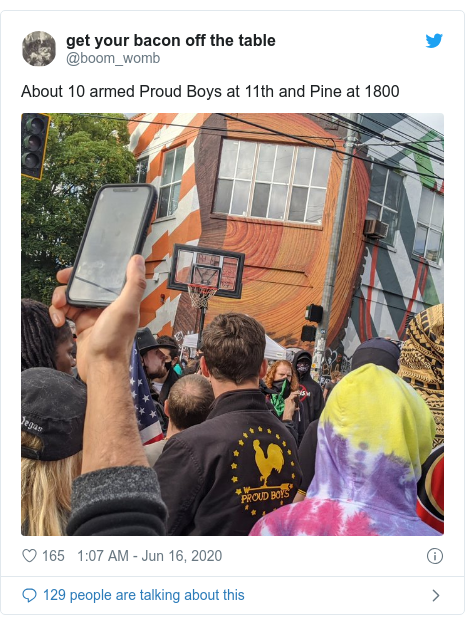 Twitter post by @boom_womb: About 10 armed Proud Boys at 11th and Pine at 1800