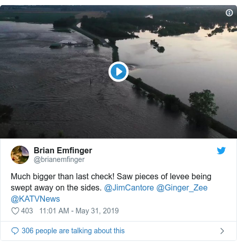 Twitter post by @brianemfinger: Much bigger than last check! Saw pieces of levee being swept away on the sides. @JimCantore @Ginger_Zee @KATVNews