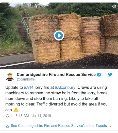Twitter post by @cambsfrs: Update to #A14 lorry fire at #Alconbury. Crews are using machinery to remove the straw bails from the lorry, break them down and stop them burning. Likely to take all morning to clear. Traffic diverted but avoid the area if you can ⚠️