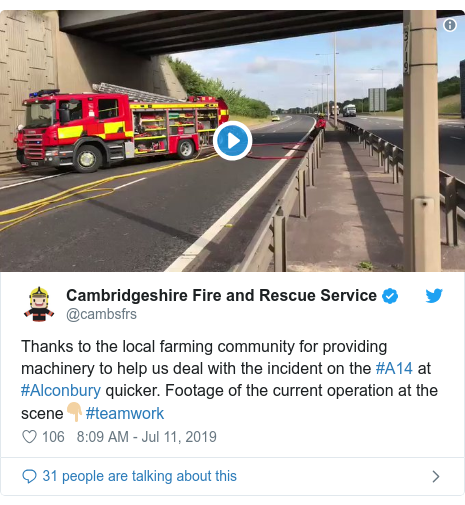 Twitter post by @cambsfrs: Thanks to the local farming community for providing machinery to help us deal with the incident on the #A14 at #Alconbury quicker. Footage of the current operation at the scene👇🏼#teamwork