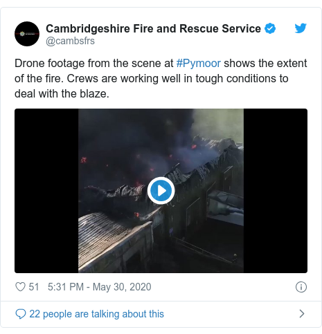 Twitter post by @cambsfrs: Drone footage from the scene at #Pymoor shows the extent of the fire. Crews are working well in tough conditions to deal with the blaze.