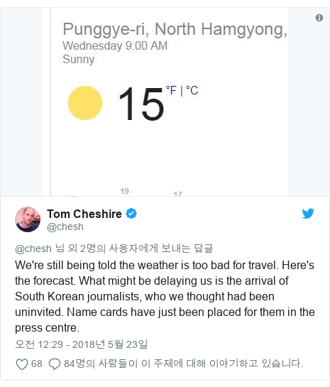 Twitter post by @chesh: We're still being told the weather is too bad for travel. Here's the forecast. What might be delaying us is the arrival of South Korean journalists, who we thought had been uninvited. Name cards have just been placed for them in the press centre.