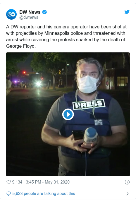 Twitter post by @dwnews: A DW reporter and his camera operator have been shot at with projectiles by Minneapolis police and threatened with arrest while covering the protests sparked by the death of George Floyd.