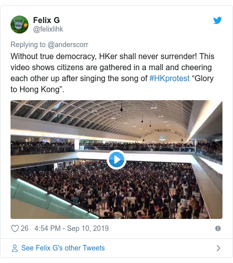 "Twitter post by @felixlihk: Without true democracy, HKer shall never surrender! This video shows citizens are gathered in a mall and cheering each other up after singing the song of #HKprotest ""Glory to Hong Kong""."