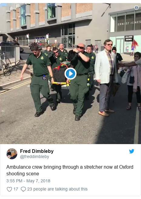 Twitter post by @freddimbleby: Ambulance crew bringing through a stretcher now at Oxford shooting scene
