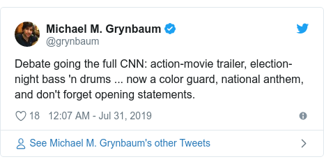 Twitter post by @grynbaum: Debate going the full CNN  action-movie trailer, election-night bass 'n drums ... now a color guard, national anthem, and don't forget opening statements.