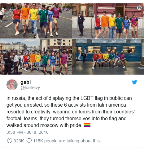 Twitter post by @harleivy: in russia, the act of displaying the LGBT flag in public can get you arrested. so these 6 activists from latin america resorted to creativity  wearing uniforms from their countries' football teams, they turned themselves into the flag and walked around moscow with pride. 🏳️🌈