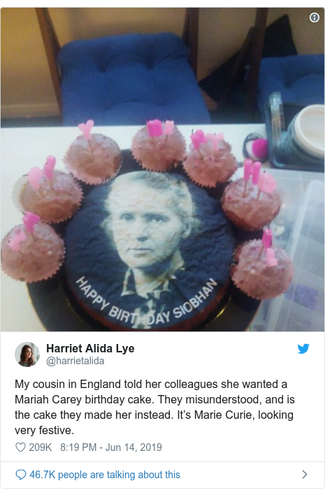 Twitter post by @harrietalida: My cousin in England told her colleagues she wanted a Mariah Carey birthday cake. They misunderstood, and is the cake they made her instead. It's Marie Curie, looking very festive.
