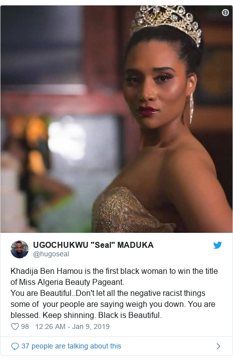 Twitter waxaa daabacay @hugoseal: Khadija Ben Hamou is the first black woman to win the title of Miss Algeria Beauty Pageant.You are Beautiful..Don't let all the negative racist things some of  your people are saying weigh you down. You are blessed. Keep shinning. Black is Beautiful.