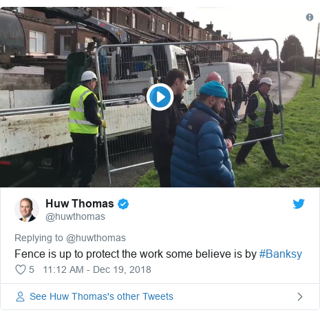 Twitter post by @huwthomas: Fence is up to protect the work some believe is by #Banksy