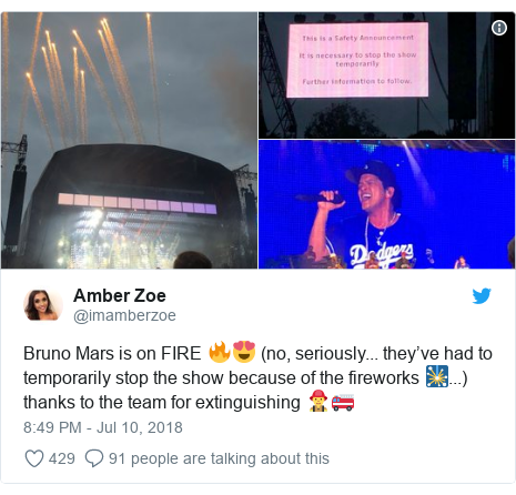 Twitter post by @imamberzoe: Bruno Mars is on FIRE 🔥😍 (no, seriously... they've had to temporarily stop the show because of the fireworks 🎇...) thanks to the team for extinguishing 👨‍🚒🚒