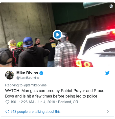 Twitter post by @itsmikebivins: WATCH  Man gets cornered by Patriot Prayer and Proud Boys and is hit a few times before being led to police.