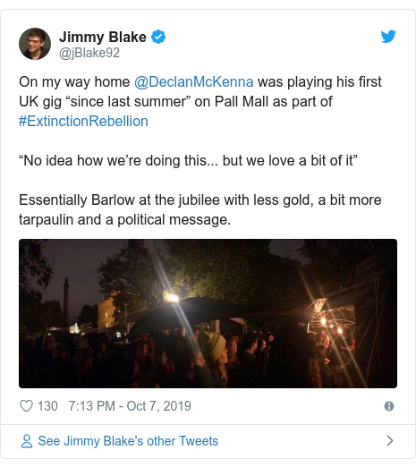 """Twitter post by @jBlake92: On my way home @DeclanMcKenna was playing his first UK gig """"since last summer"""" on Pall Mall as part of #ExtinctionRebellion""""No idea how we're doing this... but we love a bit of it"""" Essentially Barlow at the jubilee with less gold, a bit more tarpaulin and a political message."""