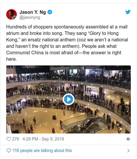 "Twitter post by @jasonyng: Hundreds of shoppers spontaneously assembled at a mall atrium and broke into song. They sang ""Glory to Hong Kong,"" an ersatz national anthem (coz we aren't a national and haven't the right to an anthem). People ask what Communist China is most afraid of—the answer is right here."