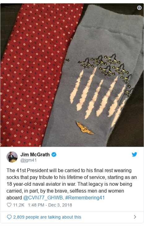 Twitter post by @jgm41: The 41st President will be carried to his final rest wearing socks that pay tribute to his lifetime of service, starting as an 18 year-old naval aviator in war. That legacy is now being carried, in part, by the brave, selfless men and women aboard @CVN77_GHWB. #Remembering41