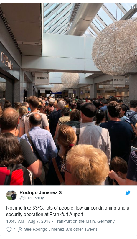 Twitter post by @jimenezroy: Nothing like 33ºC, lots of people, low air conditioning and a security operation at Frankfurt Airport.