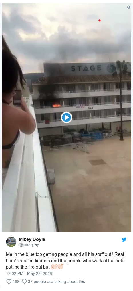 Twitter post by @jmdoyley: Me In the blue top getting people and all his stuff out ! Real hero's are the fireman and the people who work at the hotel putting the fire out but 👏🏻👏🏻