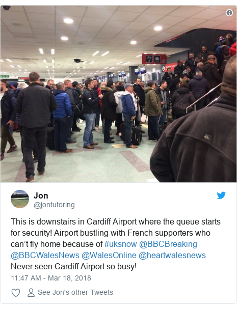Twitter post by @jontutoring: This is downstairs in Cardiff Airport where the queue starts for security! Airport bustling with French supporters who can't fly home because of #uksnow @BBCBreaking @BBCWalesNews @WalesOnline @heartwalesnews Never seen Cardiff Airport so busy!