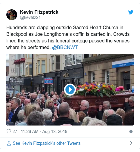 Twitter post by @kevfitz21: Hundreds are clapping outside Sacred Heart Church in Blackpool as Joe Longthorne's coffin is carried in. Crowds lined the streets as his funeral cortege passed the venues where he performed. @BBCNWT