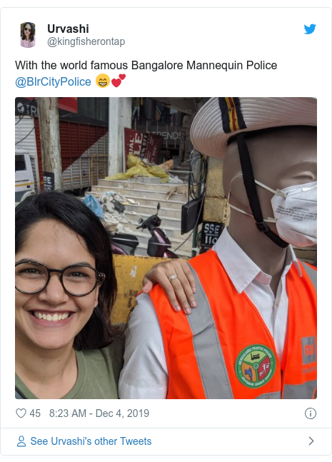 Twitter post by @kingfisherontap: With the world famous Bangalore Mannequin Police @BlrCityPolice 😁💕