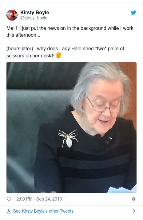 Twitter post by @kirsty_boyle: Me  I'll just put the news on in the background while I work this afternoon...(hours later)...why does Lady Hale need *two* pairs of scissors on her desk‽ 🤔