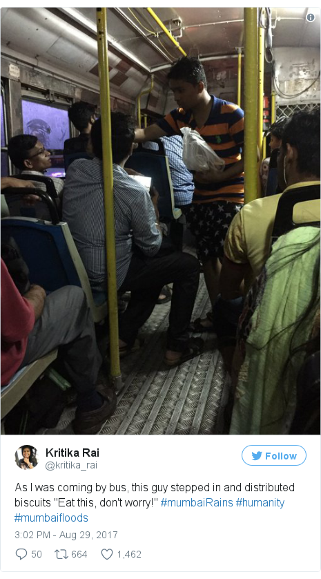 "Twitter post by @kritika_rai: As I was coming by bus, this guy stepped in and distributed biscuits ""Eat this, don't worry!"" #mumbaiRains #humanity #mumbaifloods pic.twitter.com/y1h519F2MH"
