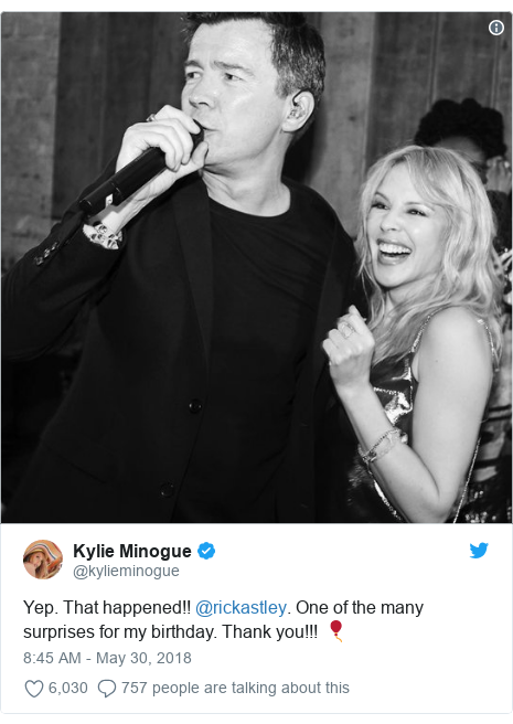 Twitter post by @kylieminogue: Yep. That happened!! @rickastley. One of the many surprises for my birthday. Thank you!!! 🎈