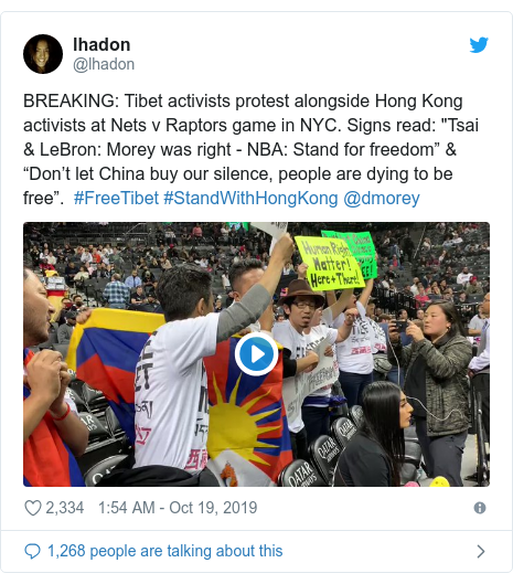 """Twitter post by @lhadon: BREAKING  Tibet activists protest alongside Hong Kong activists at Nets v Raptors game in NYC. Signs read  """"Tsai & LeBron  Morey was right - NBA  Stand for freedom"""" & """"Don't let China buy our silence, people are dying to be free"""".  #FreeTibet #StandWithHongKong @dmorey"""