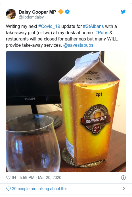 Twitter post by @libdemdaisy: Writing my next #Covid_19 update for #StAlbans with a take-away pint (or two) at my desk at home. #Pubs & restaurants will be closed for gatherings but many WILL provide take-away services. @savestapubs