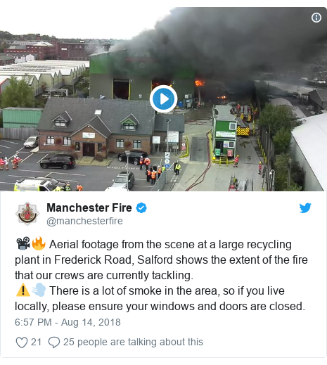 Twitter post by @manchesterfire: 📽️🔥 Aerial footage from the scene at a large recycling plant in Frederick Road, Salford shows the extent of the fire that our crews are currently tackling. ⚠️💨 There is a lot of smoke in the area, so if you live locally, please ensure your windows and doors are closed.