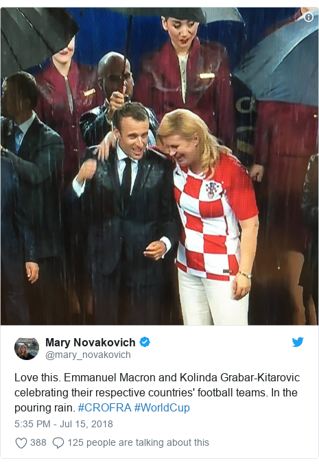 Twitter post by @mary_novakovich: Love this. Emmanuel Macron and Kolinda Grabar-Kitarovic celebrating their respective countries' football teams. In the pouring rain. #CROFRA #WorldCup