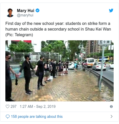 Twitter post by @maryhui: First day of the new school year  students on strike form a human chain outside a secondary school in Shau Kei Wan (Pic  Telegram)