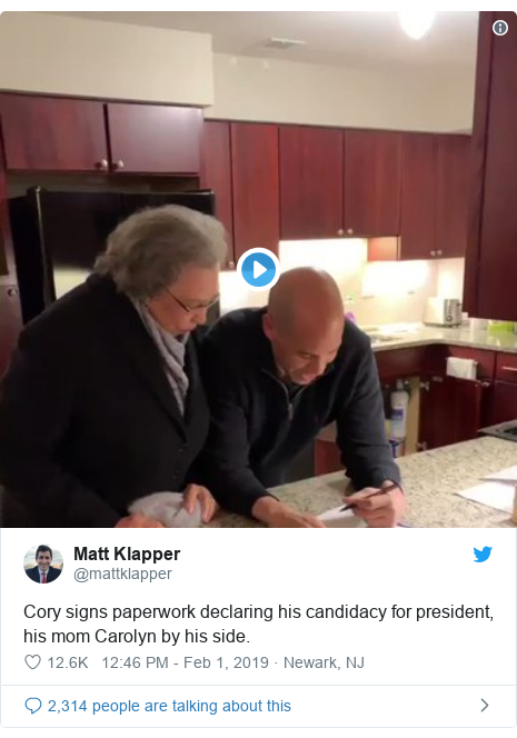 Twitter post by @mattklapper: Cory signs paperwork declaring his candidacy for president, his mom Carolyn by his side.