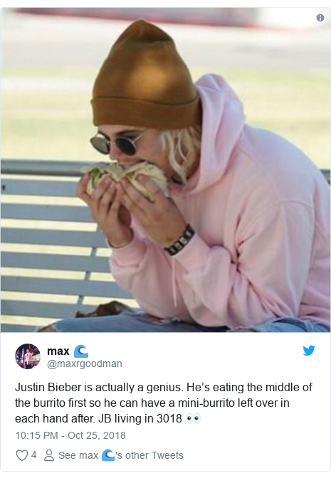 Twitter post by @maxrgoodman: Justin Bieber is actually a genius. He's eating the middle of the burrito first so he can have a mini-burrito left over in each hand after. JB living in 3018 👀