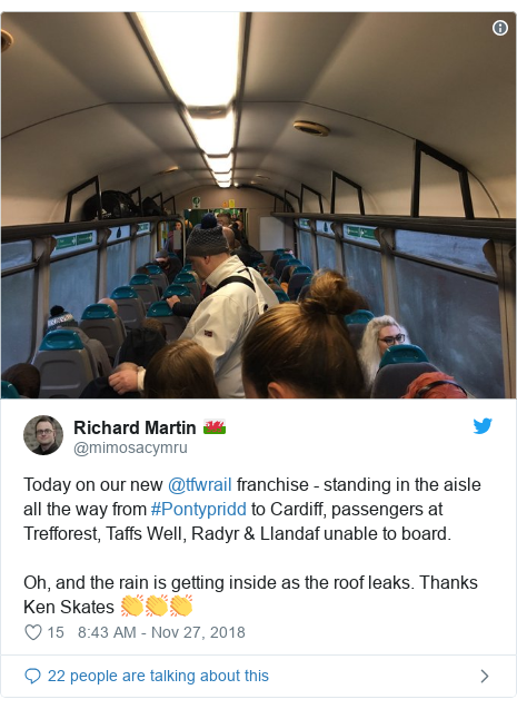 Twitter post by @mimosacymru: Today on our new @tfwrail franchise - standing in the aisle all the way from #Pontypridd to Cardiff, passengers at Trefforest, Taffs Well, Radyr & Llandaf unable to board.Oh, and the rain is getting inside as the roof leaks. Thanks Ken Skates 👏👏👏