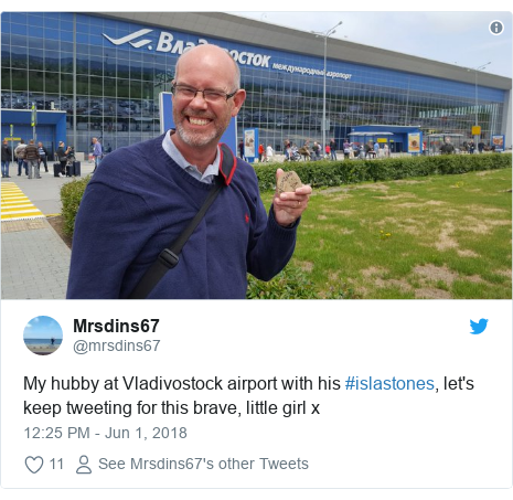 Twitter post by @mrsdins67: My hubby at Vladivostock airport with his #islastones, let's keep tweeting for this brave, little girl x