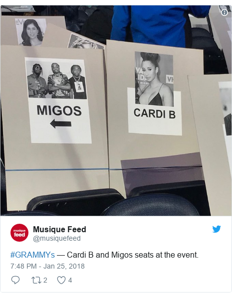 Twitter post by @musiquefeed: #GRAMMYs — Cardi B and Migos seats at the event.