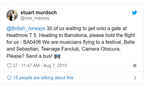 Twitter post by @nee_massey: @British_Airways 30 of us waiting to get onto a gate at Heathrow T 5. Heading to Barcelona, please hold the flight for us - BA0406 We are musicians flying to a festival, Belle and Sebastian, Teenage Fanclub, Camera Obscura. Please? Send a bus! 🚌
