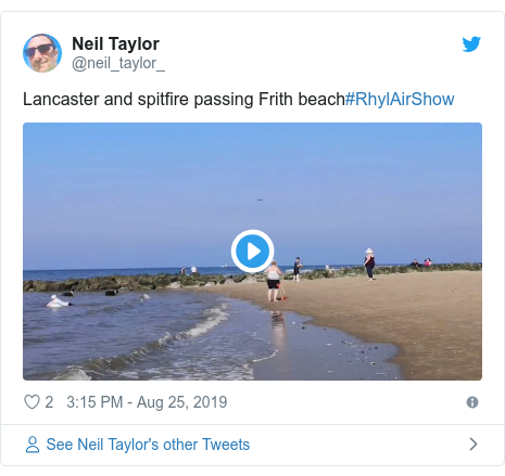 Twitter post by @neil_taylor_: Lancaster and spitfire passing Frith beach#RhylAirShow