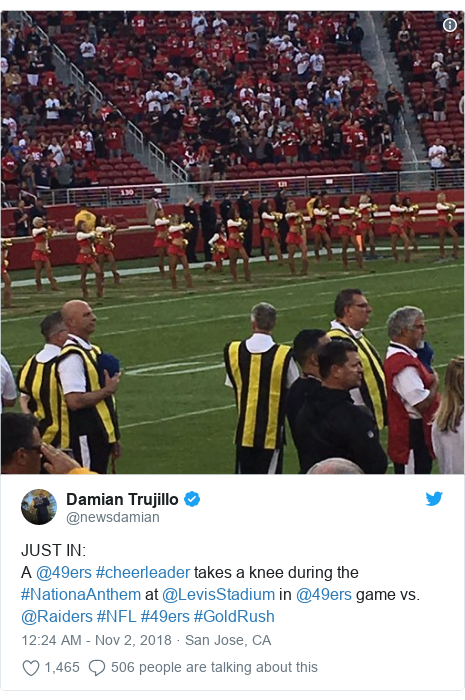 Twitter post by @newsdamian: JUST IN  A @49ers #cheerleader takes a knee during the #NationaAnthem at @LevisStadium in @49ers game vs. @Raiders #NFL #49ers #GoldRush