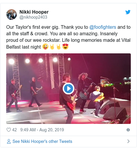 Twitter post by @nikhoop2403: Our Taylor's first ever gig. Thank you to @foofighters and to all the staff & crowd. You are all so amazing. Insanely proud of our wee rockstar. Life long memories made at Vital Belfast last night 😜🤘🤘😍