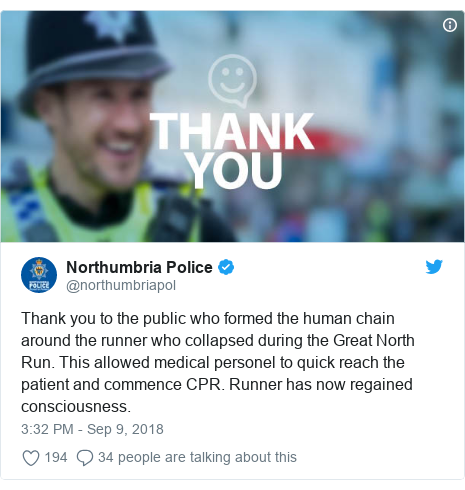 Twitter post by @northumbriapol: Thank you to the public who formed the human chain around the runner who collapsed during the Great North Run. This allowed medical personel to quick reach the patient and commence CPR. Runner has now regained consciousness.
