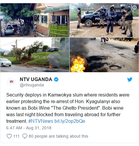 """Twitter post by @ntvuganda: Security deploys in Kamwokya slum where residents were earlier protesting the re-arrest of Hon. Kyagulanyi also known as Bobi Wine """"The Ghetto President"""". Bobi wine was last night blocked from traveling abroad for further treatment. #NTVNews"""