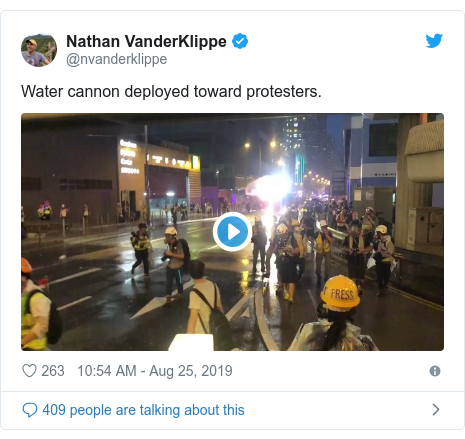 Twitter post by @nvanderklippe: Water cannon deployed toward protesters.